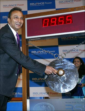 Anil Ambani, chairman of Anil Dhirubai Ambani group, strikes a gong during the listing ceremony of Reliance Power at the BSE in Mumbai on February 11, 2008.
