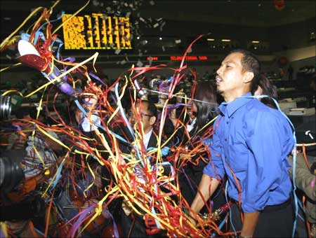 A dealer at the Jakarta Stock Exchange celebrates the end of the final trading session.