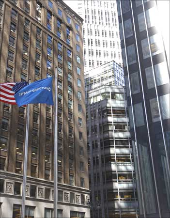 The JPMorgan Chase flag flutters outside its building (R) in front of the Bear Stearns building, NY.
