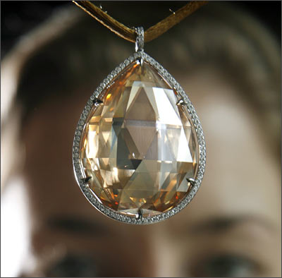 An orange-brown briolette-cut diamond