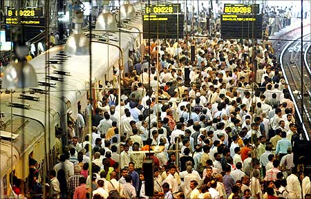 Commuters at a crowded railway station in Mumbai.