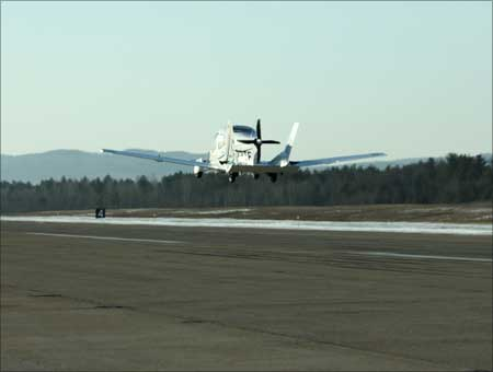 The first flight of the Terrafugia Transition in Plattsburgh, NY. Photo taken from chase truck.