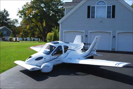 The Transition Roadable Light Sport Aircraft Proof of Concept with wings extended at home.