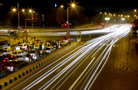 Vehicular traffic moves on a street in New Delhi.