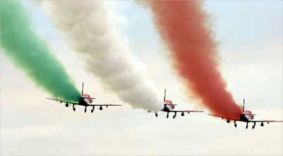 Indian Air Force 'Suryakiran' jet trainers perform during an air show.