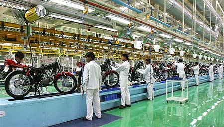 Employees work in an assembly line at Hero Honda's newly inaugurated plant in Haridwar