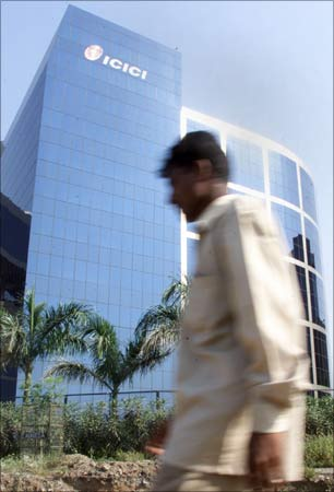 A man walks past the ICICI Bank headquarters in Mumbai.