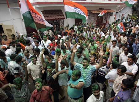 Supporters of Mamata Banerjee, chief of the regional Trinamool Congress, an ally of Congress, celebrate the party's historic victory.