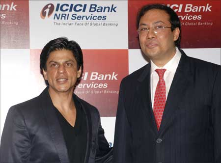 Sonjoy Chatterjee (R), managing director and chief executive officer of ICICI Bank UK, and Bollywood star Shahrukh Khan