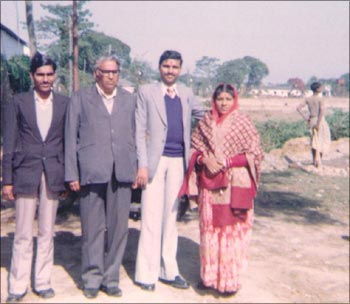 Dipak, with his parents and younger brother.