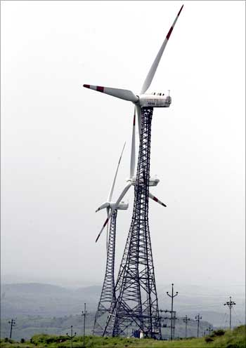 Power-generating windmill turbines are seen in Suzlon wind farm at Sanodar village near Ahmedabad.