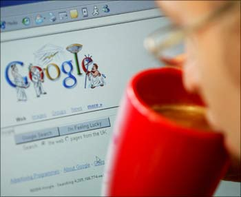 An internet surfer views the Google home page at a cafe in London.