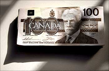 Canadian one hundred dollar bills are displayed in Toronto.