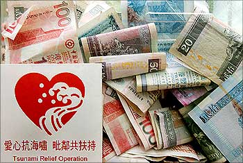 Banknotes are seen inside a donation box for tsunami victims in Hong Kong.