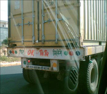 A truck with the ubiquitous message emblazoned on the rear: 'OK Tata '