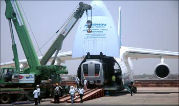 An Antonov cargo aircraft carrying a new metro rail carriage sits on tarmac at the cargo terminal of the Indira Gandhi International Airport in New Delhi.