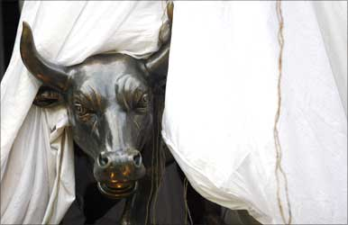 A bronze replica of a bull is seen at the gates of the Bombay Stock Exchange.