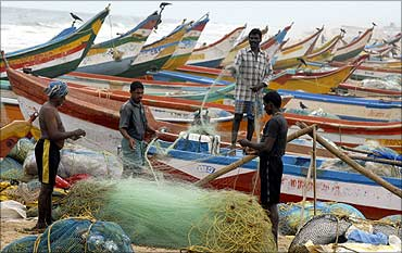 Fisherfolk's boats at a beach in Chennai.