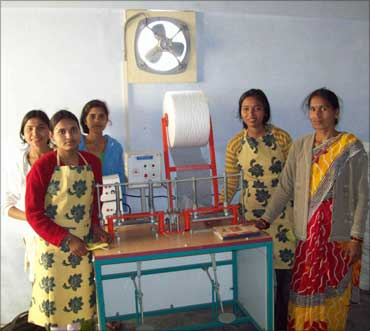 Rural women pose with the machine.