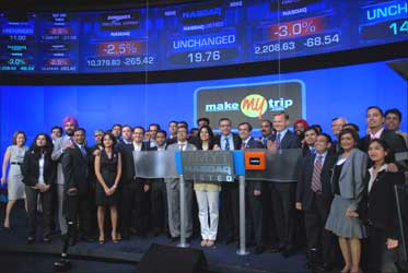 Team MakeMyTrip poses with Nasdaq officials.