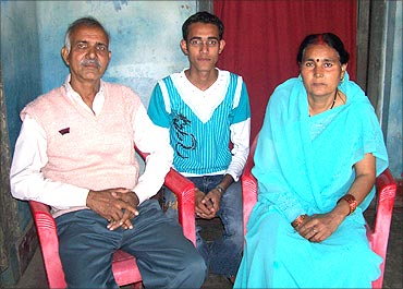 Virendra Sinha with his wife and son.