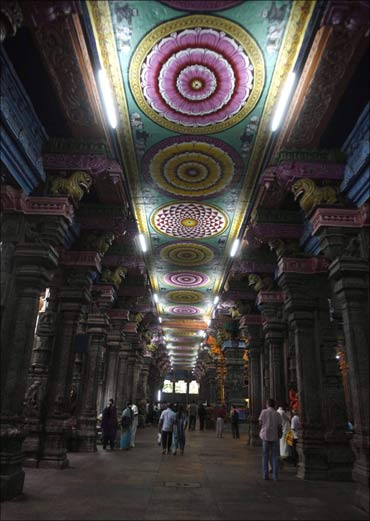 Hindu devotees leave the Meenakshi Amman temple after offering prayers in Madurai.