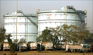 Oil tankers are stationed at a storage station of a petroleum company in Mumbai.