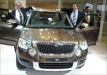 Reinhard Fleger, board member, sales and marketing, Skoda Auto (L) and Thomas Kuehl, board member, sales and marketing, Skoda Auto India.