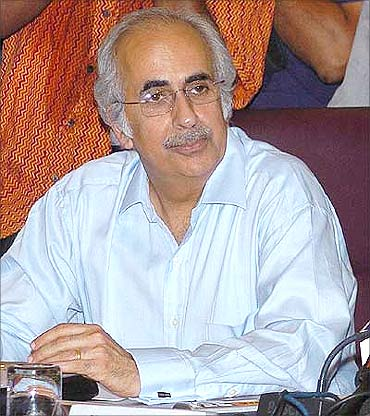 Ashok Chawla, Finance Secretary.