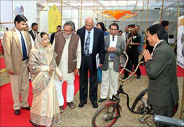 President Pratibha Patil looks at Gogoi's cycle.