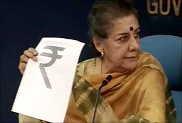 Union Broadcasting and Information Minister Ambika Soni unveiling the new rupee symbol.