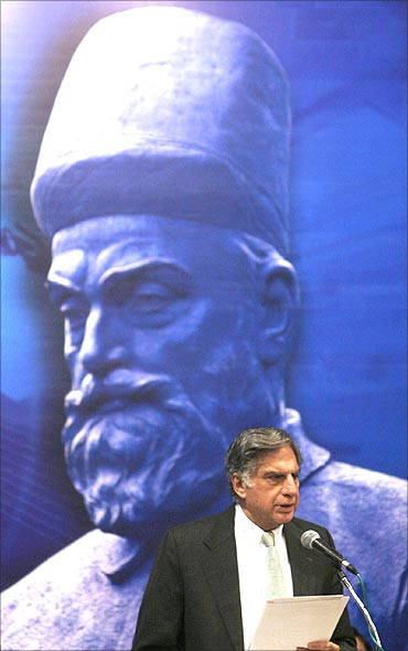 Ratan Tata speaks in front of a portrait of Tata Group founder Jamsetji Nusserwanji Tata.