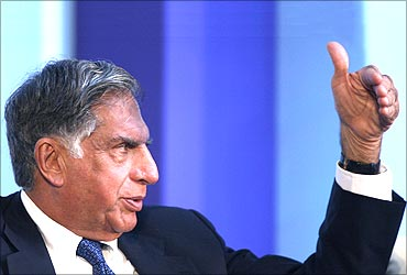 Ratan Tata gestures at a meeting.