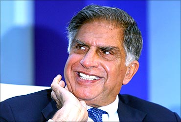 Ratan Tata smiles during an industry conference.