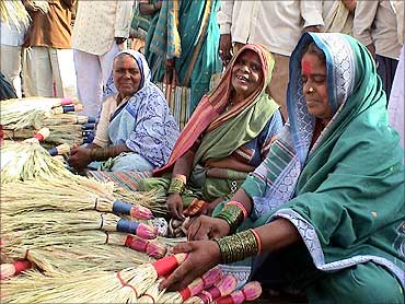 Mann Deshi Bank clients selling brooms.