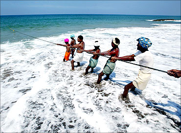 Fishermen pull in their catch in Kovalam Beach, about 20 km (12 miles) south of Trivandrum.