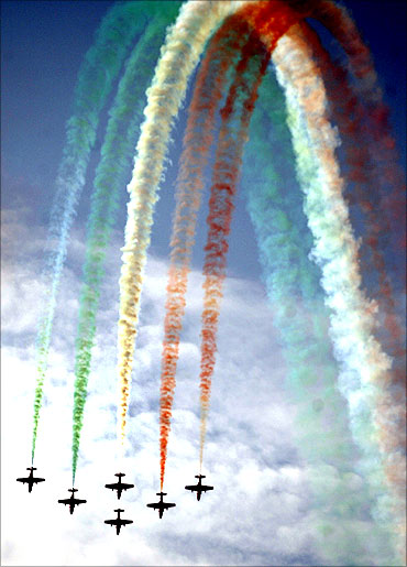 Suryakiran aircraft perform after National Defence Academy's passing-out parade in Pune.