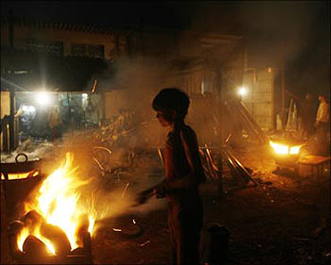 A boy works inside a metal smelting workshop on the outskirts of Mumbai.