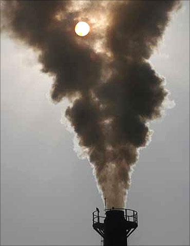 Smoke rises from a chimney of a garbage processing plant at Daddumajra village near Chandigarh.