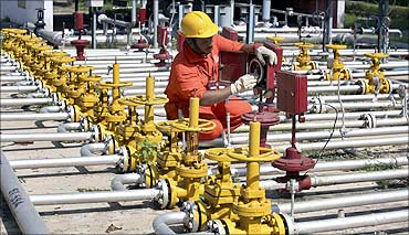 An ONGC engineer works inside the Kalol oil field in Gujarat.