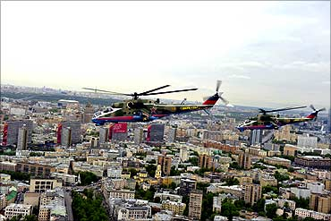 MI-24 military helicopters fly over the Moscow city.
