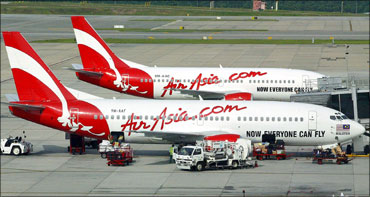 Air Asia CEO Tony Fernandes answers a question during a news conference in central Sydney.
