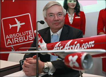 Airbus sales chief John Leahy poses with an Airbus model.