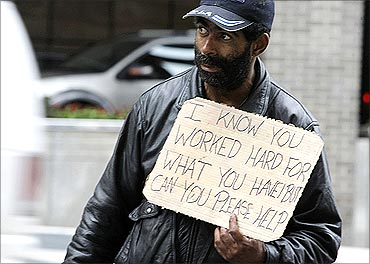 Harvey, a homeless man, begs for money along 14th Street in Washington.