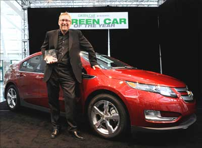 General Motors Co's US marketing chief Joel Ewanick accepts the 2011 Green Car of the Year Award for the Chevrolet Volt.