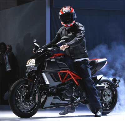 Professional motorcycle racer Nicky Hayden rides a Ducati Diavel Carbon.