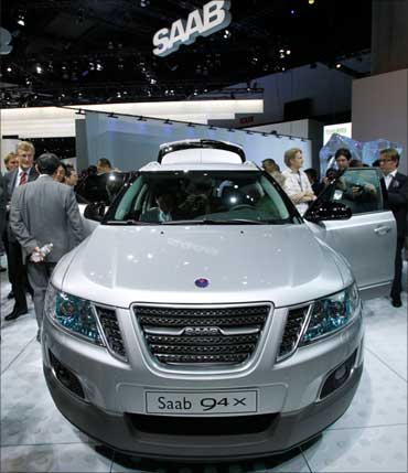 Visitors look at the SAAB 9-4X Crossover.