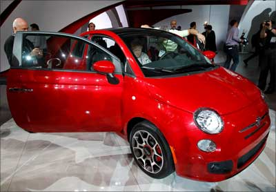 Visitors look at the new Fiat 500.