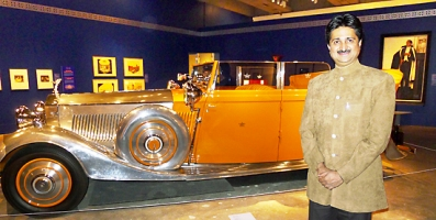 Maharaja YS Mandhatasinhji of Rajkot poses with Star of India Rolls Royce.