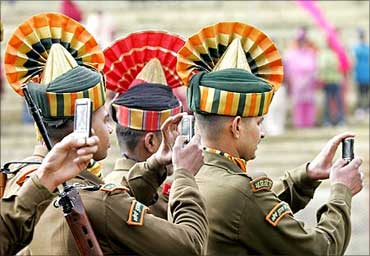 Ceremonially dressed soldiers in Srinagar, Kashmir, record the Republic Day celebrations.
